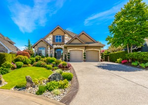 New home with landscaped lawn