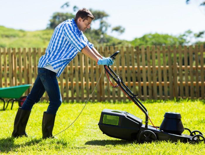 A man mows his lawn