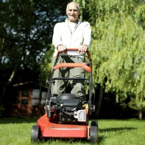 26268802 - senior man doing yard work
