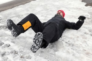 46407565 - man is lying on a icy way